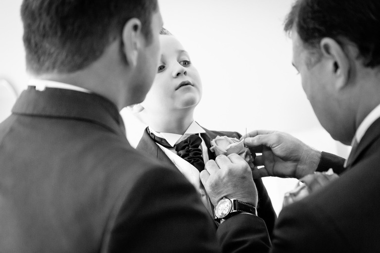 groom an dad helping with the cravat