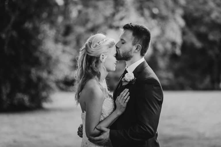 wedding photographer south wales, groom kissing bride